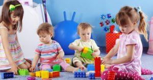 children_playing_building_blocks_fun